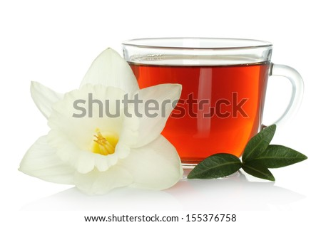 Cup of tea with flower and leaves on white background  - stock photo
