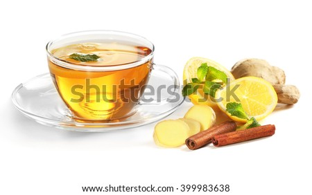 Cup of tea with ginger and cinnamon isolated on white