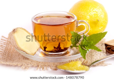 Cup of tea with ginger, honey and mint - stock photo