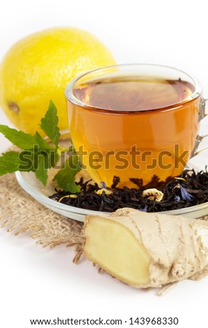Cup of tea with ginger, lemon and mint - stock photo