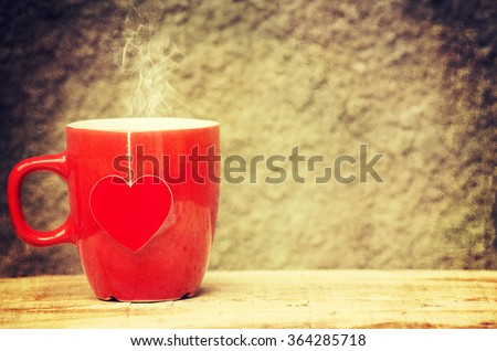 Cup of tea with heart teabag - stock photo