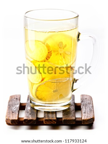 Cup of tea with lemon and ginger on white background