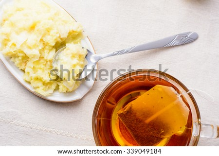 Cup of tea with lemon, honey and ginger on a napkin