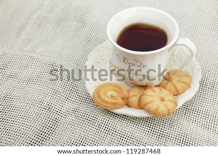cup of tea  with lots of yummy biscuits - stock photo