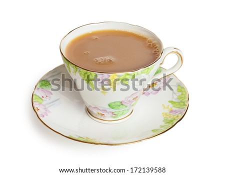 Cup of Tea with milk in a pretty bone china cup, freshly poured with bubbles on surface, front to back focus, isolated on white background, clipping path around cup and saucer. - stock photo