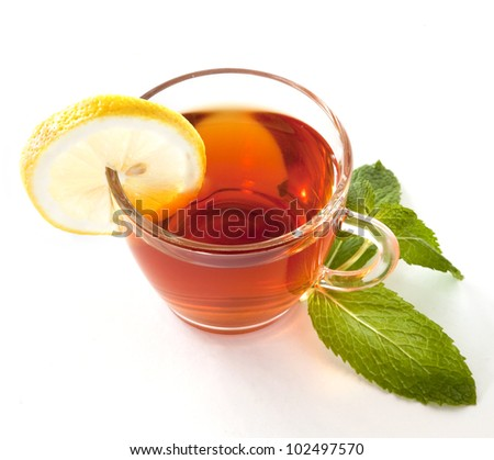 Cup of tea with mint and  lemon on the white background