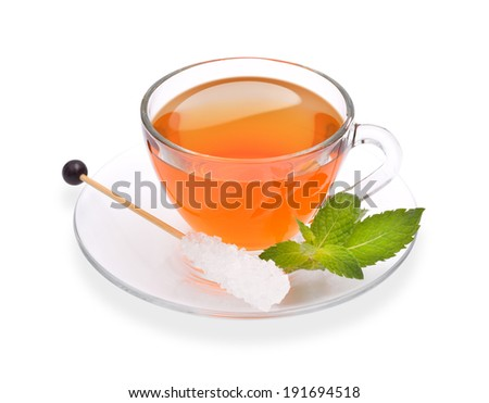 Cup of tea with mint and sugar stick isolated on white