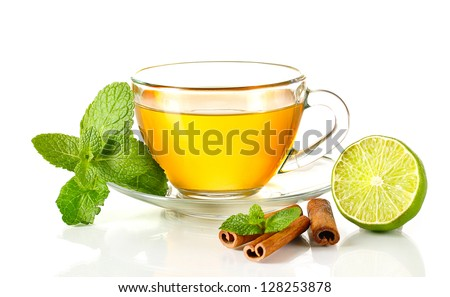 Cup of tea with mint,cinnamon and lime isolated on white - stock photo