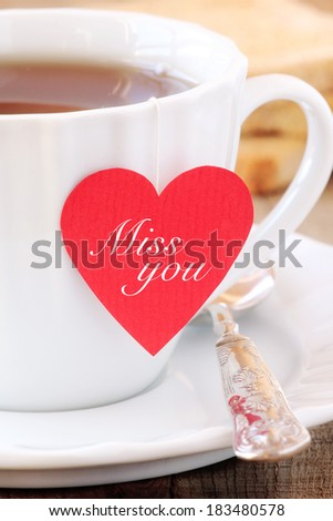 Cup of tea with red heart shaped teabag tag with a Miss you message