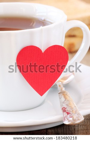 Cup of tea with red heart teabag