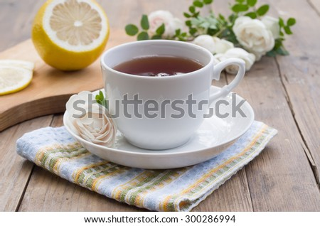 cup of tea with roses - stock photo