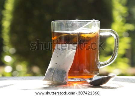 cup of tea with spoon - stock photo