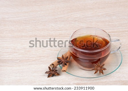 Cup of tea with star anise and cinnamon - stock photo