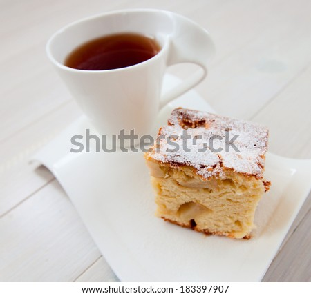 Cup of tea with tasty apple pie