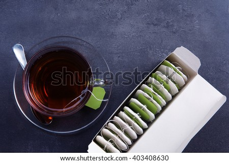 Cup of tea with tea bags - stock photo