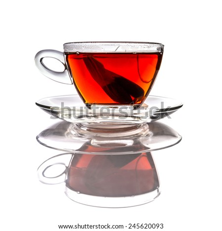 Cup of tea with teabag over white
