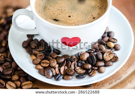Cup of Traditional Black Coffee in Mug with Hart Painted - stock photo