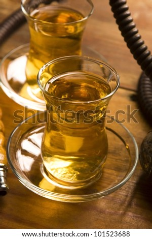 Cup of turkish tea and hookah served in traditional style - stock photo
