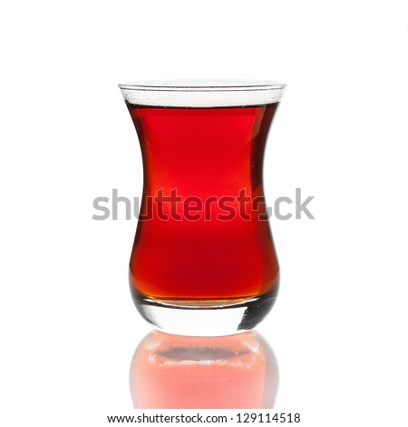 Cup of turkish tea on white background