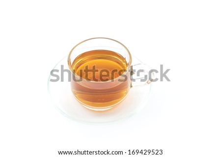 Cup of yellow tea  on white background