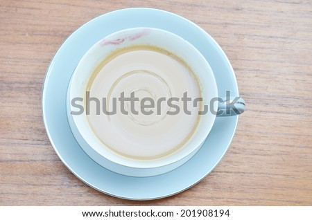 Cup off coffee with lipstic of woman on the table - stock photo