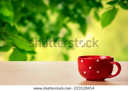 Cup on the table - stock photo