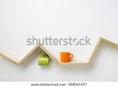 cup on wooden shelf