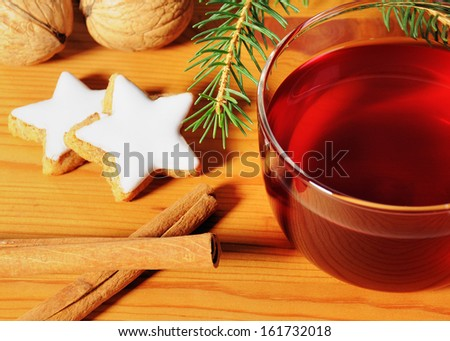 Cup tea with christmas decoration on wooden table