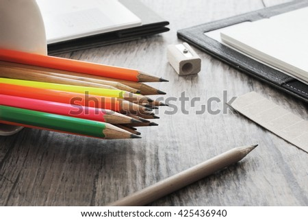 Cup white, pencil, eraser, sharpener, calendar, address book, desk.  - stock photo