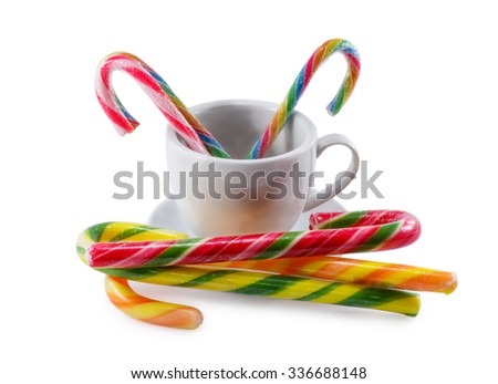 cup with candy isolated on a white background - stock photo