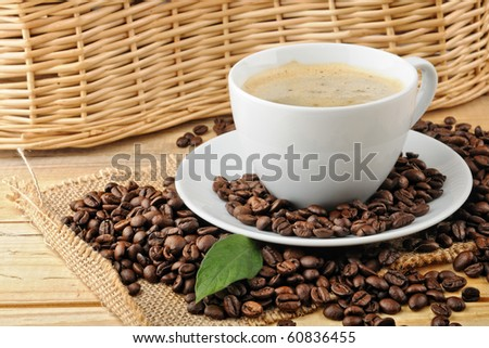 cup with coffee and coffee beans - stock photo