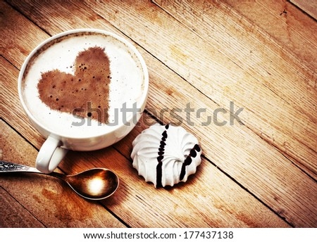 Cup with coffee and heart of coffee beanes / Fresh morning latte art coffee - stock photo