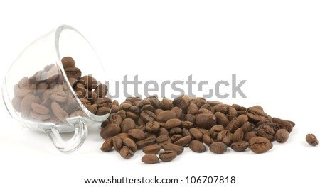Cup with coffee beans on white background - stock photo