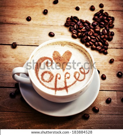 Cup with coffee/ love cup , heart drawing on latte art coffee - stock photo