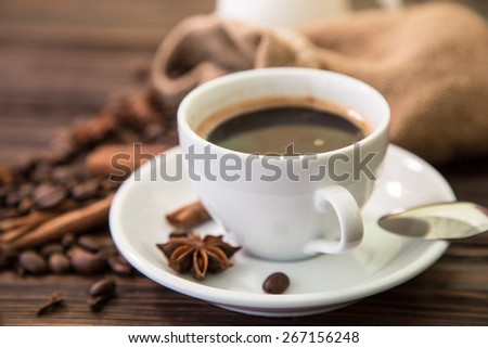 Cup with coffee on wood background