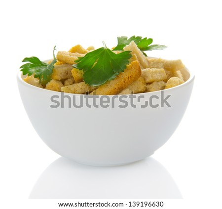 Cup with croutons and the parsley, isolated on white