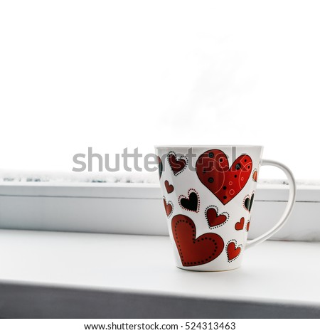 cup with heart on a window sill isolated on white background. It can be used for Valentine's Day greetings