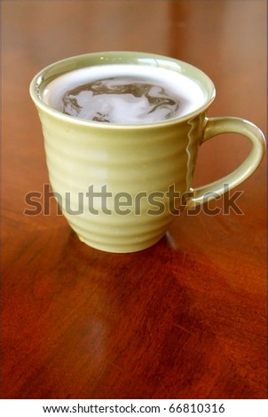 Cup with hot drink - stock photo