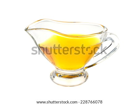 cup with linseed oil isolated on white background - stock photo