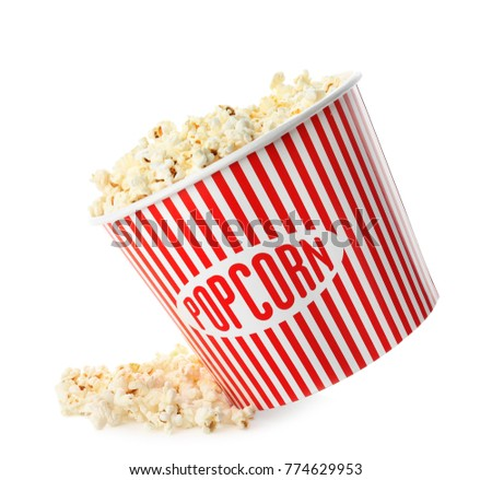Cup with popcorn on white background