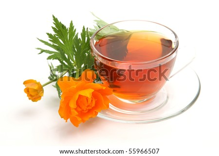 Cup with tea and a flower