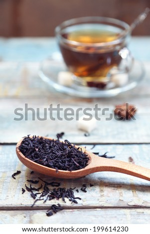 cup with tea on an old, wooden surface