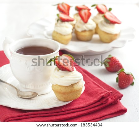 Cupcake and cup of tea