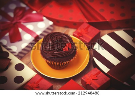 Cupcake and gifts - stock photo