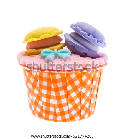 Cupcake and icing candy on top isolate on white background
