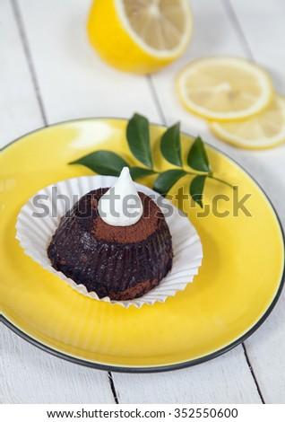 Cupcake and lemon - stock photo