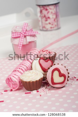 Cupcake bonbons with pink festoon - stock photo