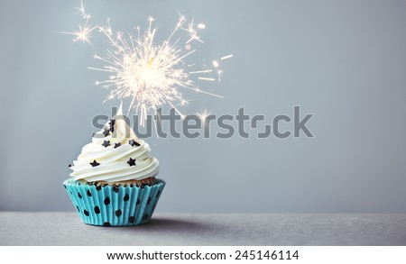 Cupcake decorated with a sparkler - stock photo