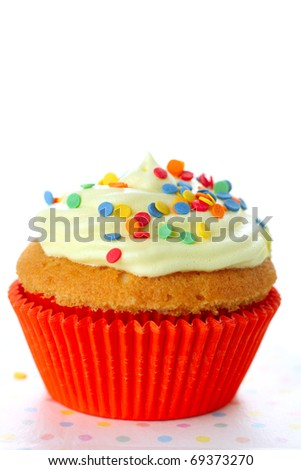 Cupcake decorated with sugar sprinkles  on white isolated background - stock photo