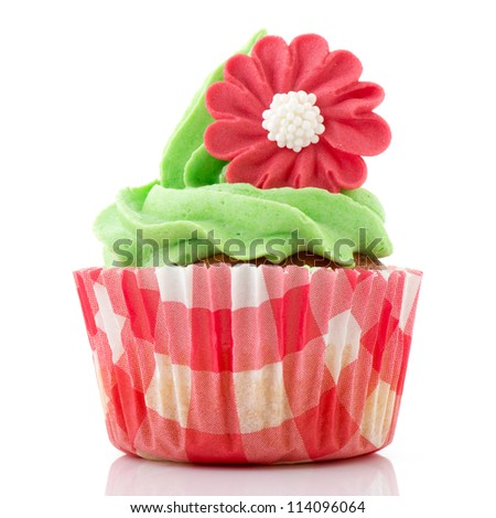 Cupcake in red and green with flower - stock photo